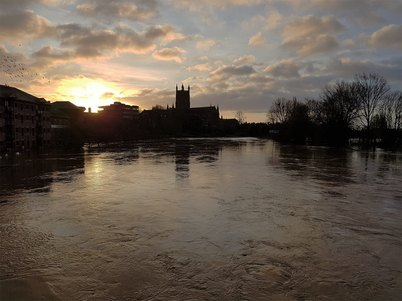 Worcester cathedral and the river Severn at dawn during a flood