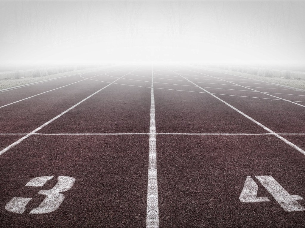 Starting block on a racetrack, looking towards a misty horizon