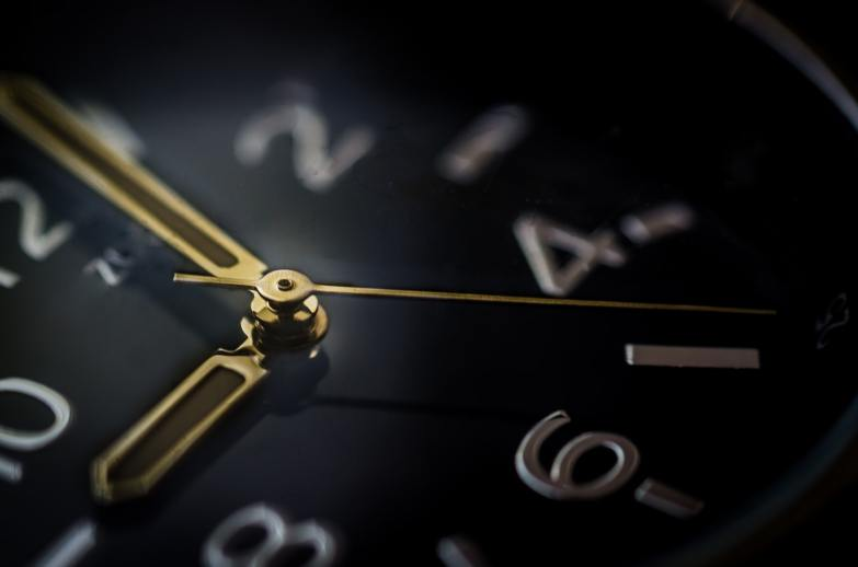 Black, white and gold clock face